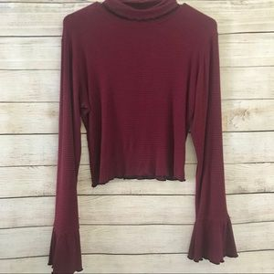 Charlotte Russe crop with bell sleeves.